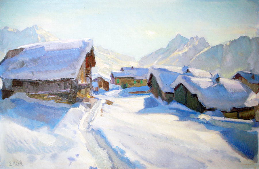 Snowy mountain huts in the sunlight